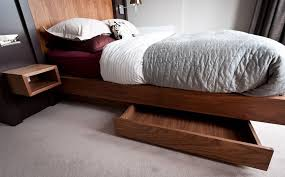 Beds with drawers Rustic Homedit Make The Most Of Your Bedroom With Hidden Bed Drawers