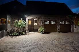 par38 outdoor led bulb 150 watt equivalent weatherproof led flood light bulb 1 500 lumens installed on luxury home above garage door