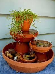 simple terracotta water fountain feature