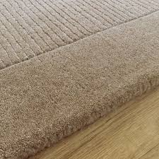 small plain taupe wool rug
