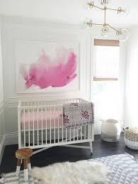 Nursery with white furniture Nimbus Modern White Nursery With Art Mural The Spruce 19 Wonderfully White Nursery Ideas