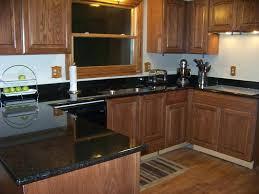 black granite kitchen countertop counters white cabinets