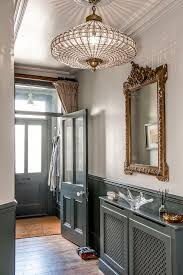 hallway ceiling lighting. the grand chandelier in entrance hall catches light beautifully vintage mirror adds additional grandeur hallway ceiling lighting