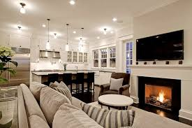 family room ideas with tv. Chic Comfy, Cozy Open Living Room Kitchen Design With Gray Sofa, Striped Pillows, Fireplace, TV And Brown Velvet Chair. Family Ideas Tv P