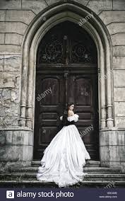 Old Doors Mysterious Woman In Victorian Dress With Old Doors Stock Photo