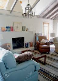 rafters living lighting. A Comfortable Seating Area By Day, Open Rafters Admit Light From The Next Room; Living Lighting N