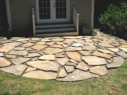 Patio stones with grass in between Outdoor Circular Shape Flagstone Patio In Backyard Artificial Turf 35 Stone Patio Ideas pictures Designing Idea