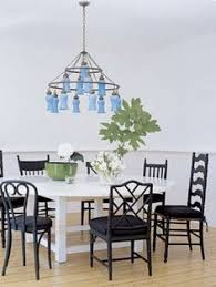 very cool love the colors mismatched chairs painted black sarah jessica parker s house in the htons