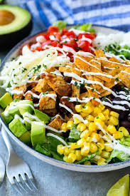 a bowl of bbq en salad topped with a drizzle of ranch dressing i understand that california pizza kitchen
