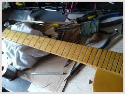 diary of a repair man gibson l6 s solidbody live4guitar cleaning out the fret slots and measuring them for the new fret wire if needed the slots were deepened a special fret tang saw