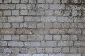 brick wall with grey cement mortar