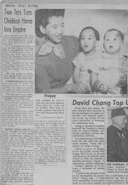hong kong search results harry w pang holds her two foster children weng mooi 2 1 2 and her brother hing wah 11 months orphans who arrived here from hong kong thursday