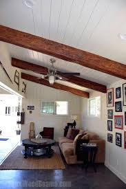 Vaulted ceiling wood beams Rustic Garage Converted Man Cave With Exposed Timber Beams Installed On White Plank Ceiling Faux Wood Beams Vaulted Ceilings With Exposed Beams Faux Wood Workshop