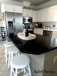 black and stainless kitchen mixing white black and stainless steel in the kitchen