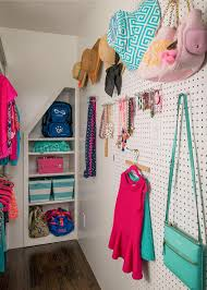 use hooks and pegboard on any closet wall space to hang purses jackets and accessories photo by