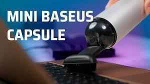 Trên tay máy hút bụi cầm tay Mini Baseus Capsule