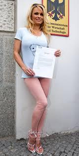 Pamela Anderson looks self conscious in nude leggings as she tries.