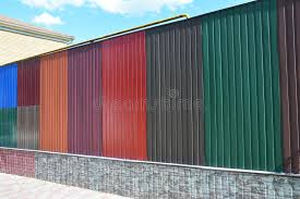 colored sheet metal stacks of various colorful metal fence panels and metal roof sheets