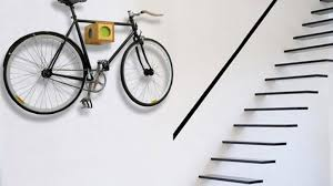 These handmade wooden bike racks create a cool, unique and easy way to  display and store your bike on the wall like the trophy it is.