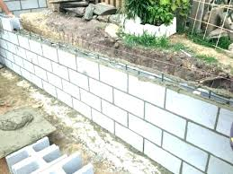 large concrete block retaining wall cinder block wall cost calculator building a garden wall with concrete