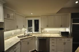 led strip lighting under cabinet brown glossy marble top table stainless faucet corber glass fronted doors