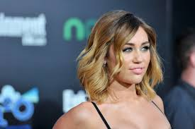 miley cyrus makeover premiere of lionsgate s the hunger games arrivals