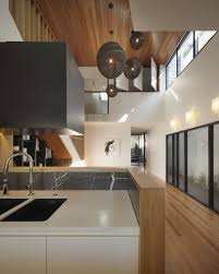 interior lighting for designers. Stunning White Kitchen Cabinet Black Sink Stainless Steel Faucet And Laminated Floor Modern Hood Hanging Lamps Hardwood Interior Lighting For Designers