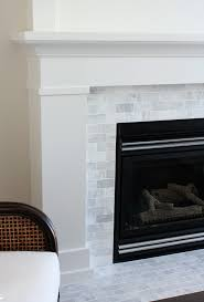 white painted fireplace with marble subway tile surround the makeover details satoridesignforliving com