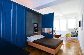 unfolding apartment example of a trendy bedroom design in other with blue walls and medium tone bedroom wall bed space saving
