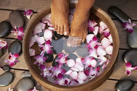 a woman s feet in a hydrating bowl as part of a pedicure procedure