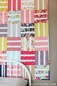 Free Easy Baby Quilt Tutorial - Quilty Love & This baby quilt has simple quilt blocks that go together quickly. Quilts  that use precuts are great for beginners because all of the fabrics are  perfectly ... Adamdwight.com