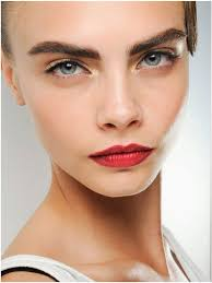 cara delevingne red lips thick eyebrows voguemagz