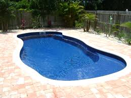 this is our very popular vista isle model it is 12 x 27 and has a tanning ledge in the shallow end it goes from 3 to 6 deep