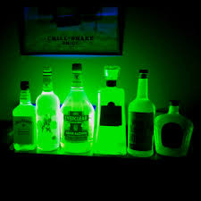 How To Decorate Empty Liquor Bottles Empty liquor bottles filled with water and highlighter fluid and 95