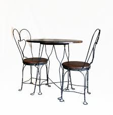 antique ice cream parlor table and chair set wrought iron and wood bistro table