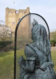 alice looking through the looking glass at guildford castle