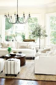 white living room with beautiful windows and lovely chandelier from favorite things beautiful white living room