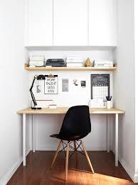 minimalist home office design. inspiration for a small scandinavian freestanding desk dark wood floor home office remodel in san francisco minimalist design