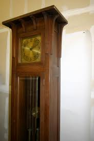 original finish with the colonial signature all original parts handsome oak grandfather clock with graceful corbels surrounding the face  on wall clock arts and crafts with colonial grandfather clock