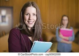 A Studying Young Teenage College Student Girl In A School