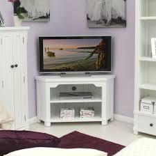 small white corner tv stand with open storage idea