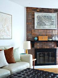 masonry fireplace with modern black glass doors