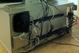 how to clean up the bird s nest of cables behind your tv cable how to clean up the bird s nest of cables behind your tv