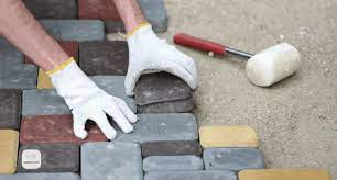 laying paving slabs on a concrete base