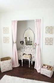 We adore the soft curtains instead of closet doors and a vintage vanity in  the closet