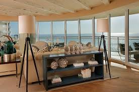 view in gallery coastal themed living room with tall tripod floor lamps by w design interiors