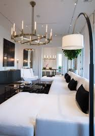 this room features cannele brass chandeliers and contemporary art for by rj raizk and ruby