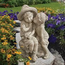 children garden statues. Garden With Perennials And Children Statue Statues