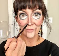 adding more light foundation right in center of the tip of the nose to create dimension also add tiny freckles on tops of cheeks with eyeliner