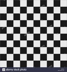 Black and white checkered floor tiles with texture. This tiles seamlessly  as a pattern